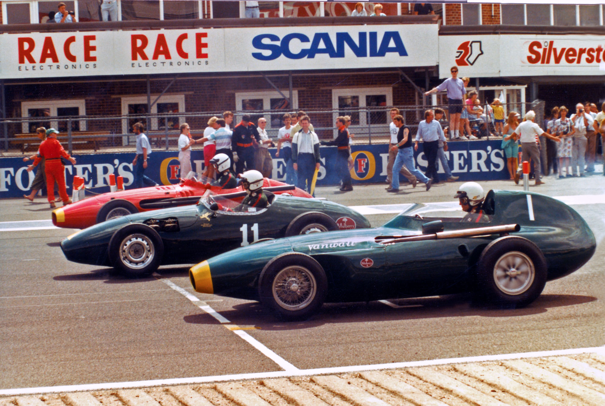 Three classic cars competing in the first classic event at Silverstone in 1990