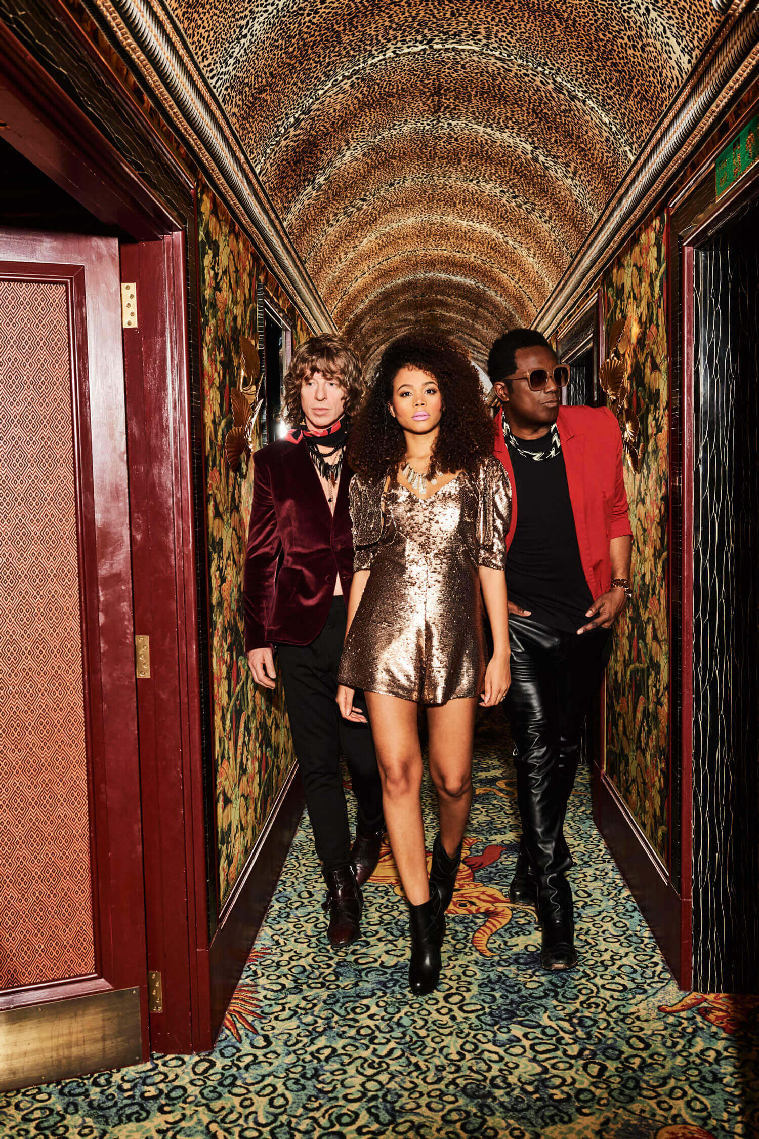 Brand New Heavies band members walking down a hallway for a promotional image for The Classic at Silverstone