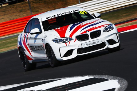 BMW M2 taking on Silverstone's famous corners.