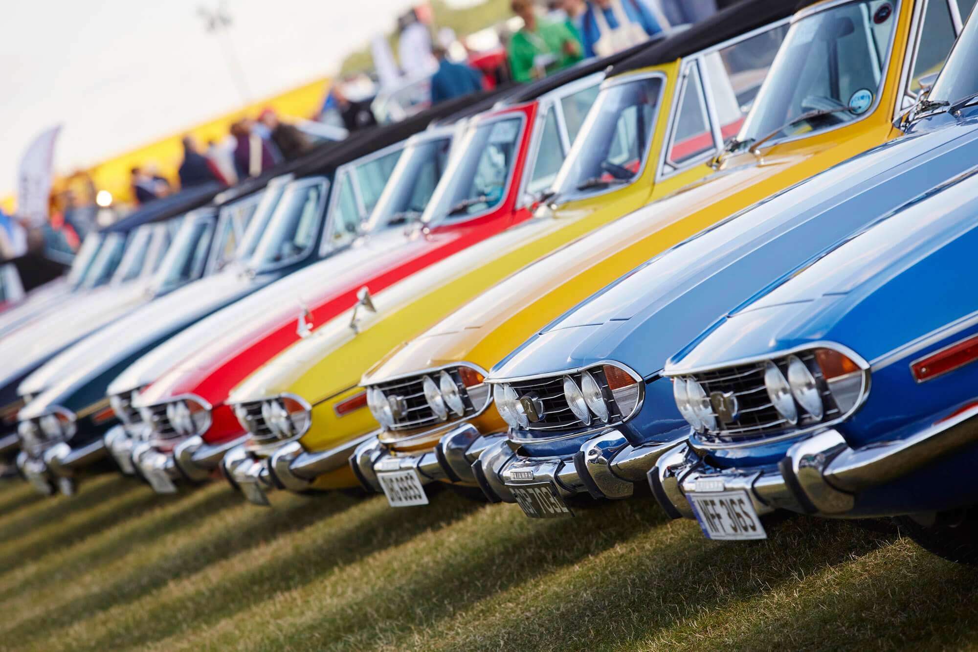 A line-up of colourful Triumph Stags at The Classic at Silverstone