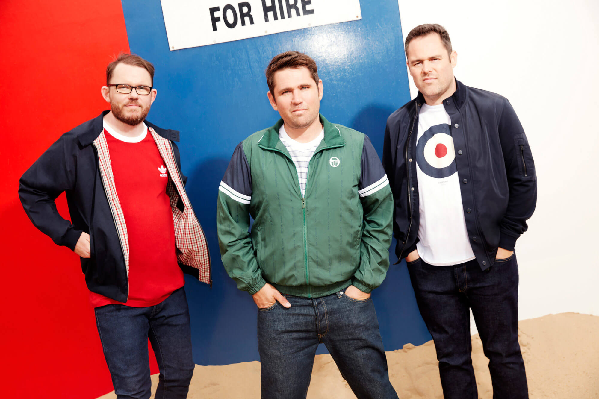 Scouting For Girls band members posing for a promotional image for The Classic at Silverstone