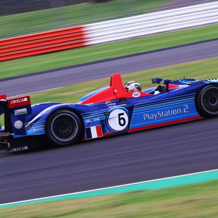A blue car taking part in the Masters Endurance Legends race at The Classic at Silverstone