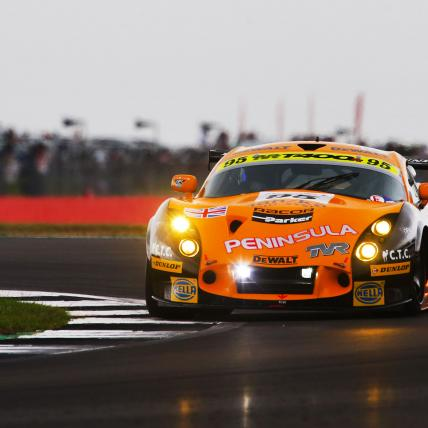 An orange car taking part in the Masters Endurance Legends race at The Classic at Silverstone