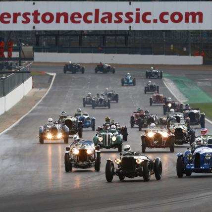 A large grid of pre war sportscars taking part in the Pre War race at The Classic at Silverstone